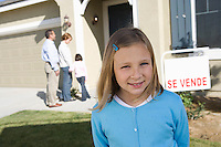 Portrait of pre-teen girl (7-9) in front of new house