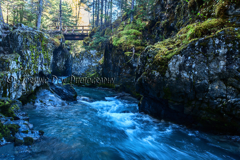 The glacier fed waters of Winner Creek cut though a rocky gorge in Girdwood, Alaska