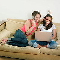 pictures in a living room of two young girls sitting on a couch looking at a laptop laughing calling by phone