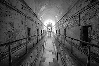 A long hallway of jail cells inside Eastern State Penitentiary in Philadelphia, PA.