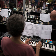 """June 21, 2014 - New York, NY : <br /> The city was flooded with music on Saturday as Make Music New York brought more than 1,300 free concerts to the city's streets and parks. The annual festival's program included the performance """"'In (Key)' - New Compositions in Celebration of Terry Riley's 'In C' @ 50 Years"""" on Cornelia Street, in front of the Cornelia Street Cafe in Greenwich Village, on Saturday afternoon. Pictured here, the group, including Eleanor Sandresky, on keyboard in foreground, perform. <br /> CREDIT: Karsten Moran for The New York Times"""