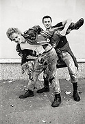 Fighting boys. High Wycombe, UK. 1980s.