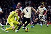 Manchester United forward Anthony Martial (9) tries to get past Burnley goalkeeper Nick Pope (1) during the Premier League match between Burnley and Manchester United at Turf Moor, Burnley, England on 28 December 2019.
