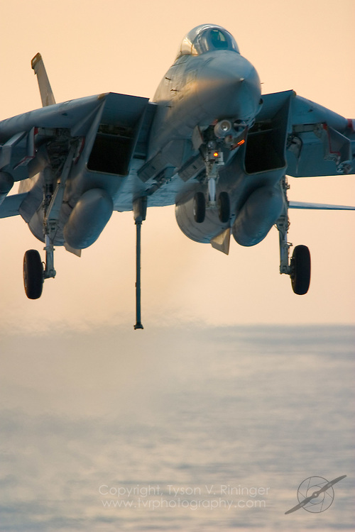 AJ203, an F-14 Tomcat from VF-213 'Blacklions', is on approach for a trap aboard the deck of the USS Theodore Roosevelt CVN-71 during sea trials prior to their 2005 Mediterranean deployment. This would be the final cruise for the F-14 Tomcat and the last time it would ever see combat.