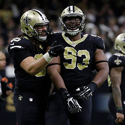 Jan 7, 2018; New Orleans, LA, USA; New Orleans Saints defensive tackle Tyeler Davison (95) and defensive tackle David Onyemata (93) celebrate after a sack of Carolina Panthers quarterback Cam Newton (not pictured) during the fourth quarter in the NFC Wild Card playoff football game at Mercedes-Benz Superdome. Mandatory Credit: Derick E. Hingle-USA TODAY Sports