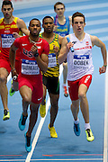(L) Ricky Babineaux of USA and (R) Patryk Dobek of Poland compete in men's relay 4x400 meters qualification during the IAAF Athletics World Indoor Championships 2014 at Ergo Arena Hall in Sopot, Poland.<br /> <br /> Poland, Sopot, March 8, 2014.<br /> <br /> Picture also available in RAW (NEF) or TIFF format on special request.<br /> <br /> For editorial use only. Any commercial or promotional use requires permission.<br /> <br /> Mandatory credit:<br /> Photo by &copy; Adam Nurkiewicz / Mediasport