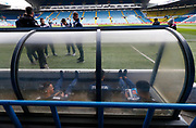 Bolton players in the away dugout reading the programme during the EFL Sky Bet Championship match between Leeds United and Bolton Wanderers at Elland Road, Leeds, England on 30 March 2018. Picture by Paul Thompson.