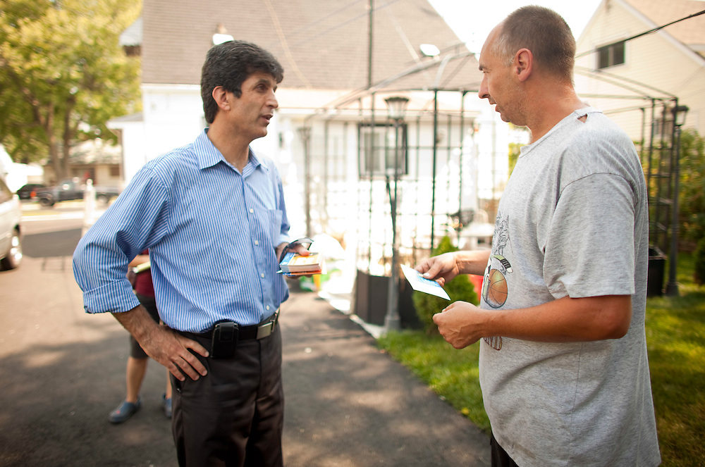 Windsor, Ontario ---11-09-02--- Windsor West NDP candidate, Helmi Charif, left, campaigns in his Windsor, Ontario, riding September 2, 2011.<br /> <br /> GEOFF ROBINS The Globe and Mail