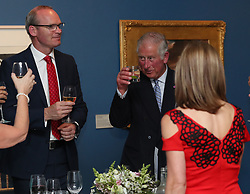 The Prince of Wales (centre) stands next to Minister for Foreign Affairs Simon Coveney and his wife Ruth, as they attend a dinner at Crawford Art Gallery, as part of his tour of the Republic of Ireland with the Duchess of Cornwall. PRESS ASSOCIATION Photo. PRESS ASSOCIATION Photo. Picture date: Thursday June 14, 2018. See PA story ROYAL Charles. Photo credit should read: Brian Lawless/PA Wire