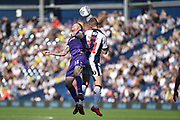 West Bromwich Albion midfielder Chris Brunt (11) heads the ball under pressure from Stoke City midfielder James McClean (11) during the EFL Sky Bet Championship match between West Bromwich Albion and Stoke City at The Hawthorns, West Bromwich, England on 1 September 2018.