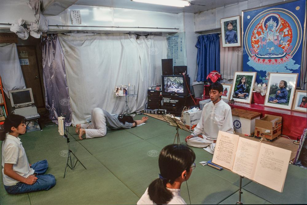 ©Tom Wagner 2004<br /> The Aum Yokohama Meditation center Asahara & His children on the TV<br /> Japan Religion