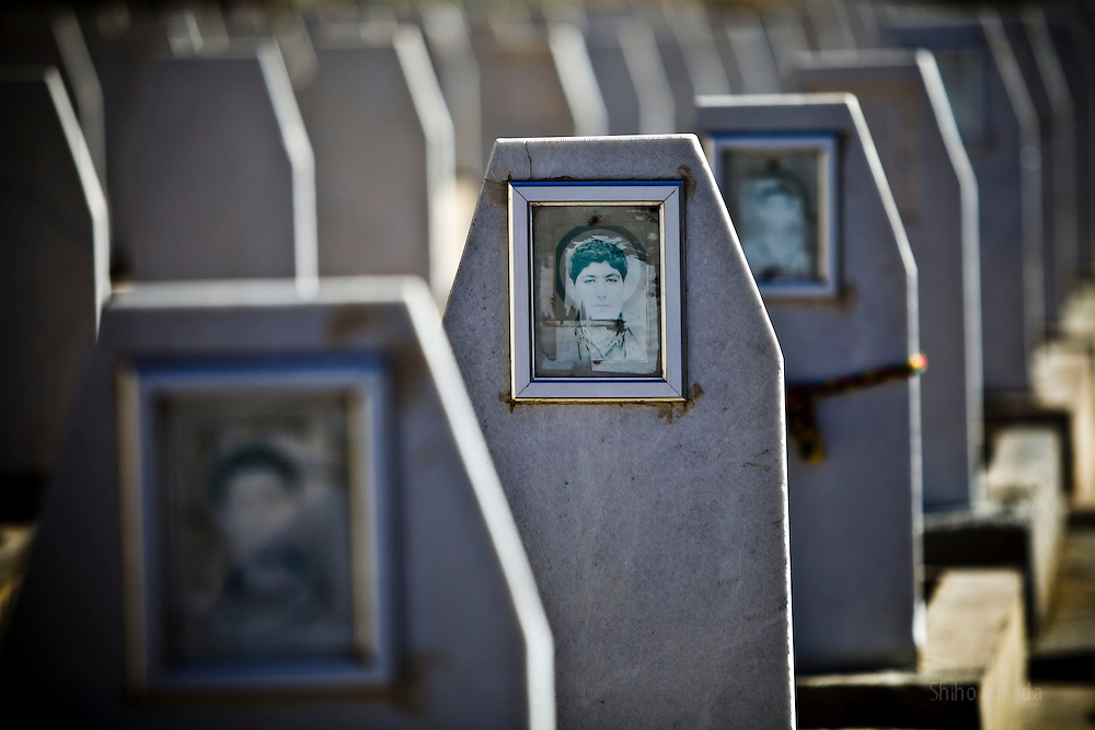 Photos of deceased PKK members are displayed on gravestones at Mehmet Karasungur Cemetery, one of PKK graveyard, in Qandil Mountains, Iraqi Kurdistan.