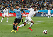 Nicol&aacute;s Lodeiro of Uruguay and Raheem Sterling of England during the 2014 FIFA World Cup match at Arena Corinthians, Sao Paulo<br /> Picture by Andrew Tobin/Focus Images Ltd +44 7710 761829<br /> 19/06/2014