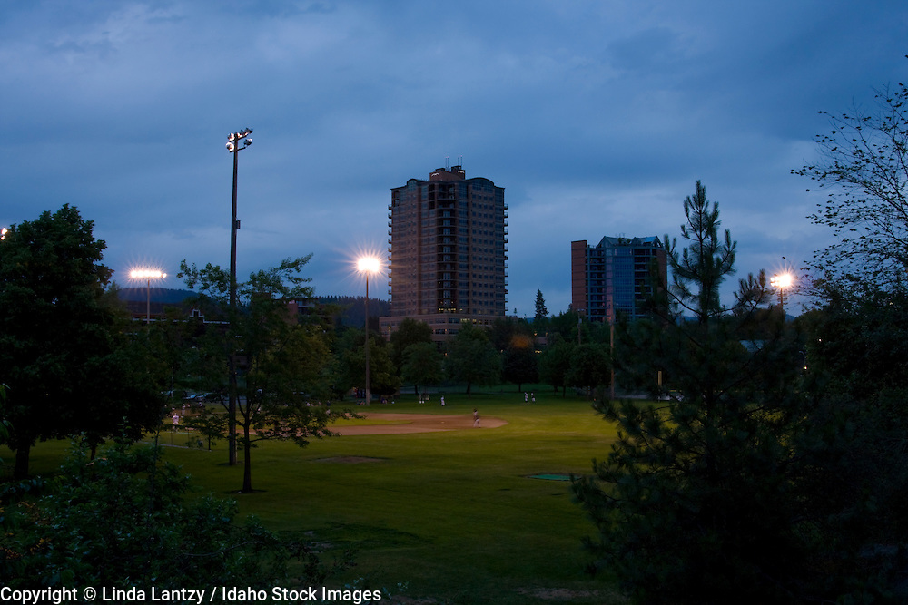 Idaho, North, Coeur d' Alene. A night game of American Legion Baseball being played under the lights of McCuen Field in downtown Coeur d' Alene.