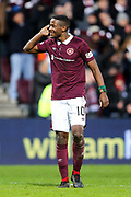 Arnaud Djoum (#10) of Heart of Midlothian gestures to the Hibernian supporters following the William Hill Scottish Cup 4th round match between Heart of Midlothian and Hibernian at Tynecastle Stadium, Gorgie, Scotland on 21 January 2018. Photo by Craig Doyle.