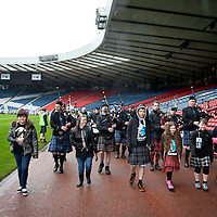 Images from The Glasgow Kiltwalk 2013. The children of the Kiltwalk lead them out of the stadium.