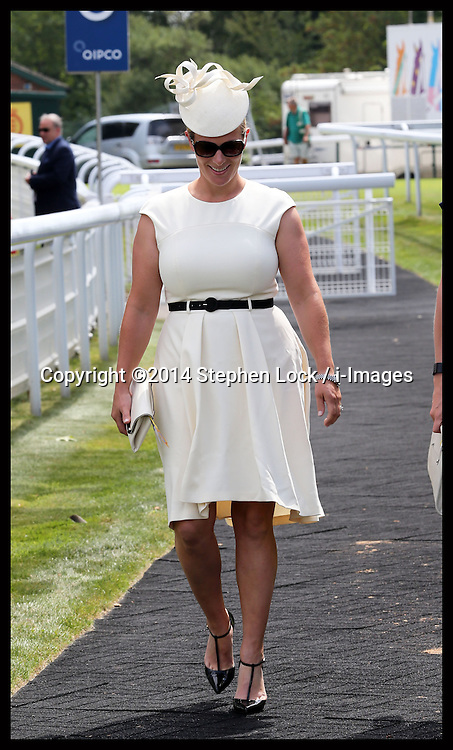 Image licensed to i-Images Picture Agency. 31/07/2014. London, United Kingdom. Zara Phillips arriving at Ladies Day at Glorious Goodwood. . Picture by Stephen Lock / i-Images