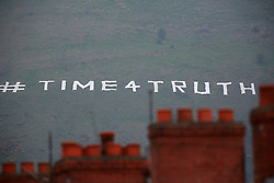 """A hashtag #TIME4TRUTH placed there by Irish Republicans is seen on Black Mountain in west Belfast, Saturday, May 3rd, 2014. Several hundred people have been attending a rally demanding the release of Sinn FÈin leader Gerry Adams who has been arrested. Gerry Adams spent a third night in police custody in connection with the 1972 murder of mother-of-10 Jean McConville.West Belfast mother Jean McConville was abducted and murdered by the Provisional IRA and secretly buried on the beach. In 1999, the IRA finally admitted that it had killed McConville and eight others of the """"Disappeared"""". The IRA claimed she had been passing information about republicans to the British Army. Sinn Fein leader Gerry Adams has spent a third night in police custody in connection with the 1972 murder of mother-of-10 Jean McConville at Antrim PSNI Police Station in Northern Ireland Picture by Paul McErlane / i-Images"""