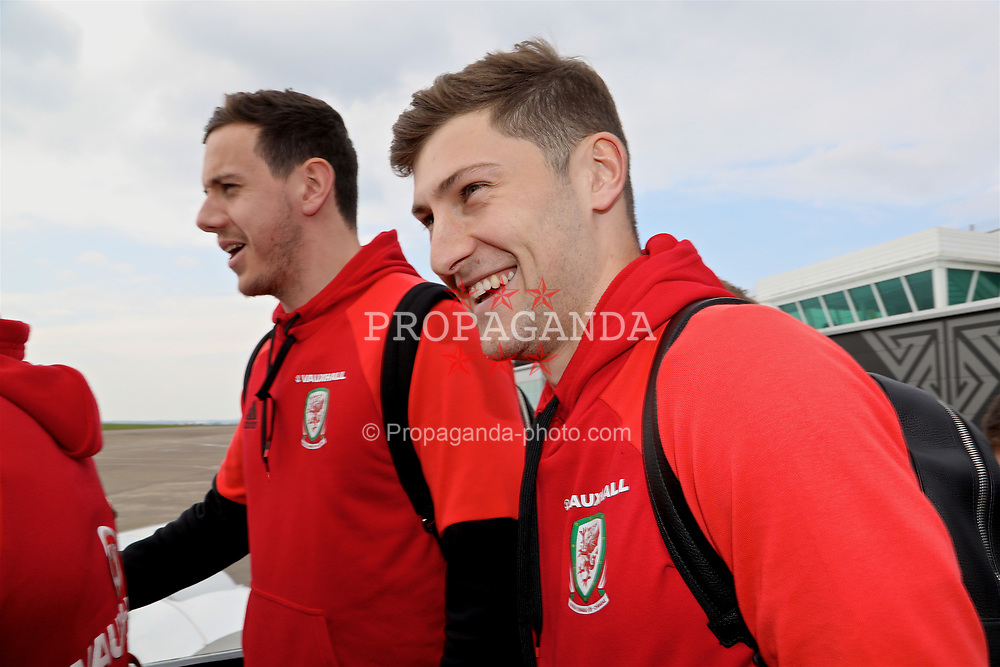 CARDIFF, WALES - Thursday, March 23, 2017: Wales' goalkeeper Daniel Ward and Ben Davies boards the team plane as the squad depart Cardiff Airport to fly to Dublin ahead of the 2018 FIFA World Cup Qualifying Group D match against Republic of Ireland. (Pic by David Rawcliffe/Propaganda)
