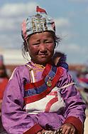 Mongolia. dalanzadgad  , Gobi desert. Kid's horse race; during the Nadaam    /  une des gagnante de la course (2 ans) dans le stade de Oulan Bator pour la remise des prix. Elle porte un bonnet décoré avec le Soyambo, l'emblême national mongol , et un petit drapeau rouge.  /46     /  P0000565