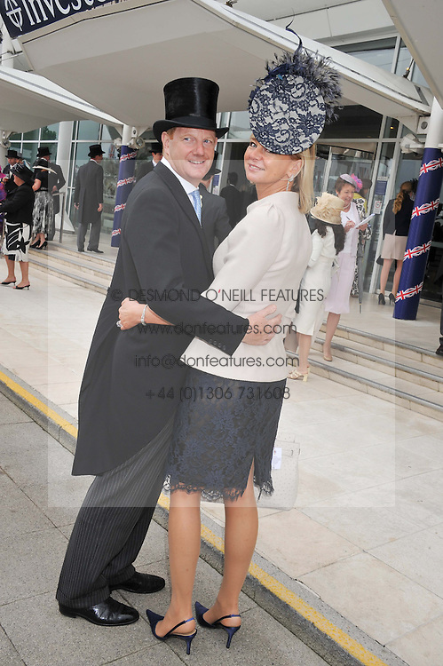 The EARL & COUNTESS OF DERBY at the 2012 Investec sponsored Derby at Epsom Racecourse, Epsom, Surrey on 2nd June 2012.
