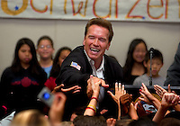 California Governor, Arnold Schwarzenegger, shakes the hands of students at Natomas Charter School, Wednesday May 25, 2005.