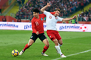 Chorzow, Poland - 2018 March 27: (L) Son Heung-min from South Korea fights for the ball with (R) Maciej Rybus from Poland while Poland v South Korea International Friendly Soccer match at Stadion Slaski on March 27, 2018 in Chorzow, Poland.<br /> <br /> Mandatory credit:<br /> Photo by © Adam Nurkiewicz / Mediasport<br /> <br /> Adam Nurkiewicz declares that he has no rights to the image of people at the photographs of his authorship.<br /> <br /> Picture also available in RAW (NEF) or TIFF format on special request.<br /> <br /> Any editorial, commercial or promotional use requires written permission from the author of image.