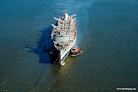 Aerial view of the USS SEATTLE being pulled down the Delaware river starting trip to Seattle for dismantlement into a museum