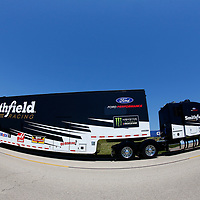 The hauler for Aric Almirola (10) drives through the infield during hauler parking for the Overton's 400 at Chicagoland Speedway in Joliet, Illinois .