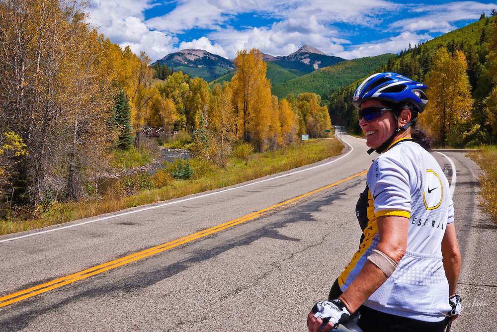 Cyclist on the San Juan Skyway (Highway 145), San Juan National Forest, Colorado