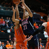 Arizona's Chance Comanche (21) is fouled while driving to the basket during the second  half of an NCAA college basketball game against Oregon State, in Corvallis, Ore., Thursday, Feb. 2, 2017. Arizona won 71-54. (AP Photo/Timothy J. Gonzalez)