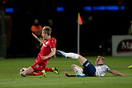 GOSFORD, AUSTRALIA - OCTOBER 02: Adelaide United midfielder Benjamin Halloran (26) and Central Coast Mariners forward Matthew Simon (19) collide during the FFA Cup Semi-final football match between Central Coast Mariners and Adelaide United on October 02, 2019 at Central Coast Stadium in Gosford, Australia. (Photo by Speed Media/Icon Sportswire)