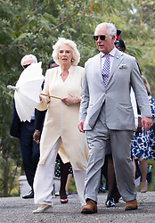 The Prince of Wales and the Duchess of Cornwall after the Official Welcome Ceremony and Reception with the Prime Minister Dr. Keith Mitchell at the Grenada Houses of Parliament Building during a one day visit to the Caribbean island of Grenada.