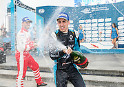 Swiss driver Sébastien Buemi (R)of the Renault e.Dams racing team celebrates on the podium after taking first place. German Nick Heidfeld (L) driving for Mahindra Racing Formula E Team takes 3rd <br /> Hong Kong's 1st Formula E  electric car racing take place in the Central Harbourfront on a street track.