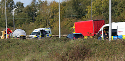 Portbury,Bristol,Avon Thursday 28th September 2017 <br /> Man dead after police 'surround car and shoot into it' near Bristol<br /> Police and the IPCC continue to investigate a shooting near Bristol. South Wales Police have been Called to supervise the investigation yards from the Avon and Somerset Police and Fire Headquarters.<br /> Officers from South Wales have carried out finger searches of the are following yesterday fatal shooting. The red Vehicle that was shot out was taken away undercover on the back of a low loader recovery truck. Three other vehicle have also been taken away. An Avon and Somerset marked Police vehicle was covered in a silver tarpaulin sheet and also driver away from the scene. &copy;UKNIP
