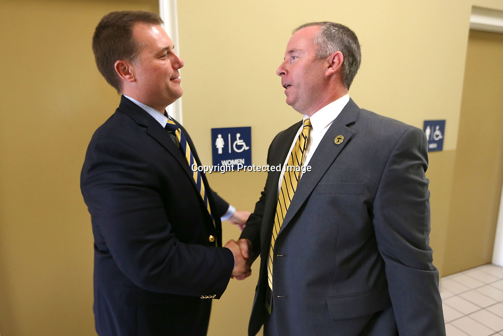 Jason Harris, current Tupelo High School Principal, congratulates Art Dobbs, on being named the new Tupelo High School Principal as they stand in the hall of the Hancock Leadership Center Tuesday in Tupelo.