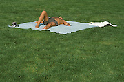 Person tanning on the grass