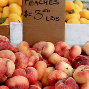Fresh organic donut peaches background, photo taken at local farmers market, in New York City