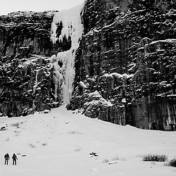 Mark Howell and Brian Merry approach the ice climb Nemesis WI6, Stanley Headwall, Canada