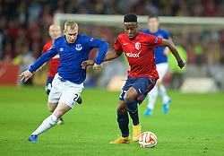 LILLE, FRANCE - Thursday, October 23, 2014: Lille OSC's Divock Origi in action against Everton's Tony Hibbert during the UEFA Europa League Group H match at Stade Pierre-Mauroy. (Pic by David Rawcliffe/Propaganda)