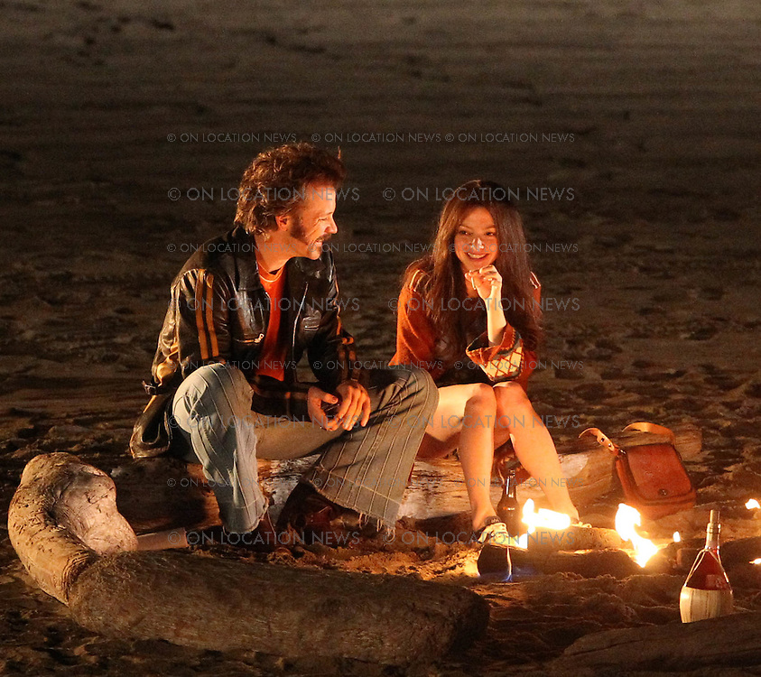 January 22nd 2012 Redondo Beach, CA. ***EXCLUSIVE*** Amanda Seyfried and Peter Sarsgaard cuddle and kiss on the beach while smoking Marijuana and  drinking alcohol for a scene in Lovelace. Seyfried was seen needing to adjust her high cut jean shorts several times through the evening. Amanda Seyfried also treated the crew to gourmet sprinkled cupcakes as a thank you for their hard work during the very cold night on the beach. The crew applauded when hearing the announcement of cupcakes. Photo by Eric Ford/ On Location News 1/818-613-3955 info@onlocationnews.com