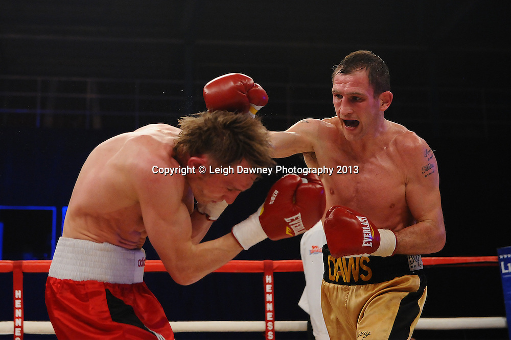 Lenny Daws (gold shorts) defeats Arek Malek in a Light Welterweight contest on 15th March 2014 at the Rivermead Leisure Centre, Reading, Berkshire. Promoted by Hennessy Sports. © Leigh Dawney Photography 2014.