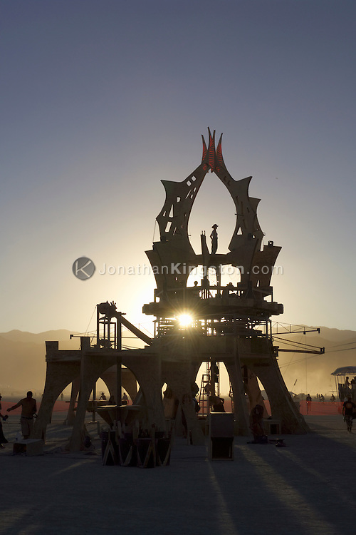 "BLACK ROCK CITY, NV:  ""The Machine"" by Seattle's Machine crew, a collaborative group of 18 artists and dozens of crew members sits on the playa at sunset in Black Rock City, Nevada."