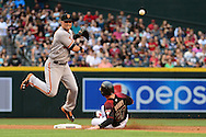 PHOENIX, AZ - MAY 14:  Joe Panik #12 of the San Francisco Giants makes the force out at second base on Brandon Drury #27 of the Arizona Diamondbacks in the fourth inning at Chase Field on May 14, 2016 in Phoenix, Arizona.  (Photo by Jennifer Stewart/Getty Images)