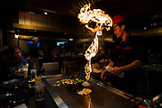 Hibachi chef Isma performs fiery culinary tricks during dinner at Sumo Japanese Steakhouse & Sushi Bar in Madison, Wisconsin, Wednesday, March 21, 2018.