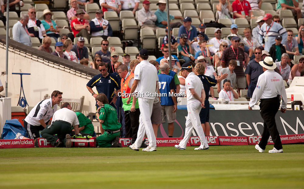 A steward is hit by an advertising board during the second npower Test Match between England and Pakistan at Edgbaston, Birmingham.  Photo: Graham Morris (Tel: +44(0)20 8969 4192 Email: sales@cricketpix.com) 08/08/10