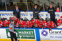KELOWNA, CANADA - JANUARY 28: Head coach, Mike Johnston, associate coach, Kyle Gustafson, and equipment manager Mark Brennan of the Portland Winterhawks stand on the bench and speak to players against the Kelowna Rockets on January 28, 2017 at Prospera Place in Kelowna, British Columbia, Canada.  (Photo by Marissa Baecker/Shoot the Breeze)  *** Local Caption ***