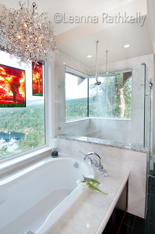 When you're hundreds of feet above a neighbor you can have windows in the shower and bath. Vancouver Island, BC Canada