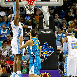 October 29, 2010; New Orleans, LA, USA; Denver Nuggets power forward Al Harrington (7) dunks over New Orleans Hornets small forward Peja Stojakovic (16) of Serbia during the fourth quarter at the New Orleans Arena. The Hornets defeated the Nuggets 101-95.  Mandatory Credit: Derick E. Hingle