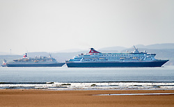Edinburgh. Scotland, UK. 13 April, 2020. Eight crew members on Fred Olsen cruise liner berthed in the Firth of Forth have tested positive for Covid-19. Crew members on the Black Watch liner ( on left) are showing minor symptoms of the virus. The Black Watch is one of three out of service cruise liners currently berthed in the Firth of Forth during the Coronavirus pandemic. Pictured; Black Watch liner off left and Balmoral on right. Iain Masterton/Alamy Live News